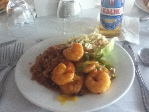 Caribbean shrimp curry with cole slaw, peas & rice; a cool Kalik beer : Nassau Yacht Club, Nassau, The Bahamas